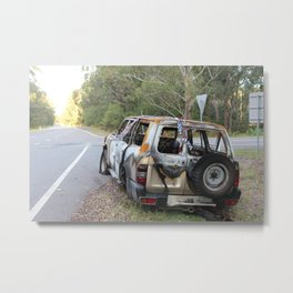 Burnt out car on a deserted road Metal Print