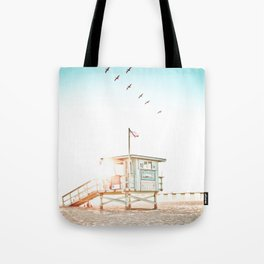 Pelicans Over the 10th Street Lifeguard Tower Tote Bag