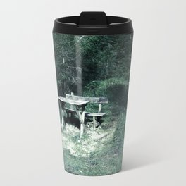Bench and table in the dark forest Travel Mug