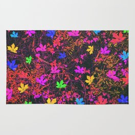 maple leaf in yellow green pink blue red with red and orange creepers plants background Rug