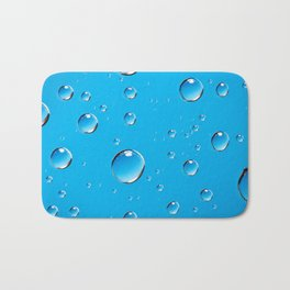 Water Droplets On Blue Bath Mat