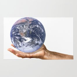 Holding planet Earth Rug