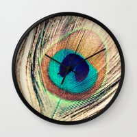 peacock feather Wall Clocks featuring Peacock Feather  by Laura Ruth