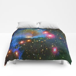 A Nebula showing off its colors Comforters