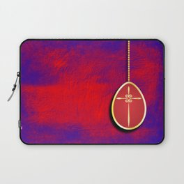 Gold cross in red egg hanging against a rich red and purple Laptop Sleeve