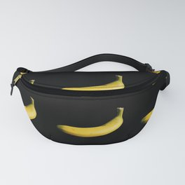 Cropped bananas on black background Fanny Pack