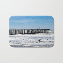 A Panoramic View Of Pismo Beach Pier, Surfers And Ocean Bath Mat