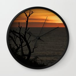silhouette of trees with beautiful sunset over the sea Wall Clock