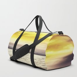 warm sunset sky with ocean view Duffle Bag