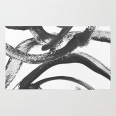 Interlock black and white paint swirls Rug