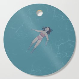 Girl Floating in the Ocean Cutting Board