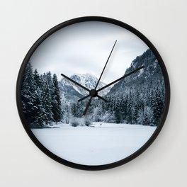 Mountains and frozen lake Zgornje Jezersko Wall Clock