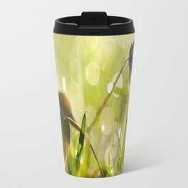 Beautiful spring - first flower little anemone with beautiful bokeh in green background Travel Mug