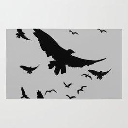FLOCK OF RAVENS IN GREY SKY Rug
