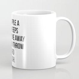 An apple a day keeps anyone away if you throw it hard enough Coffee Mug