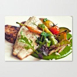 Branzino filet, chorizo dumplings, baby vegetables and spinach sauce Canvas Print