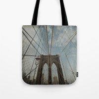 brooklyn bridge Tote Bags featuring Brooklyn Bridge by Jean-Pierre Ducondi