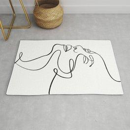 Flora—Abstract face minimal line art  Rug