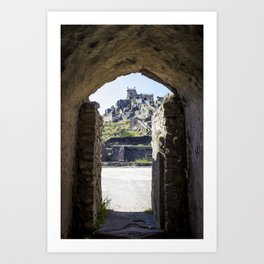 Looking through a Stone Mughal Design Arch towards Peak of Golconda Fort in Hyderabad, India Art Print