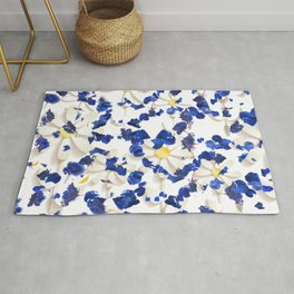 white daisies and blue cyclamens floral pattern Rug