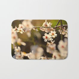 Winter spring. Almond flowers Bath Mat