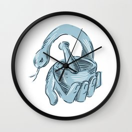 Hand Holding Mortar and Pestle Snake Drawing Wall Clock