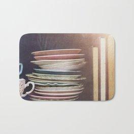 Vintage teacups, saucers and books Bath Mat