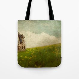 Building in a field Tote Bag