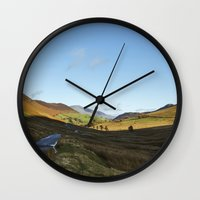 cassia beck Wall Clocks featuring Views from Keskadale and Keskdale Beck back down the Pass. Lake District, UK. by liamgrantfoto