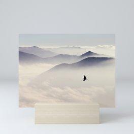 Bird flying in mountains Mini Art Print