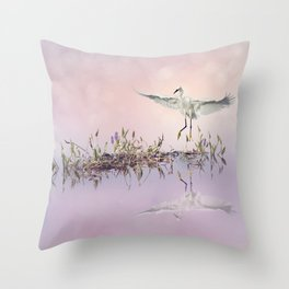 Snowy Egret in flight over lake at sunset Throw Pillow