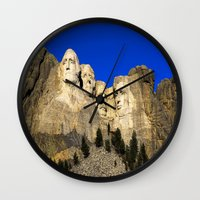 rushmore Wall Clocks featuring Mount Rushmore  by Brett Knight