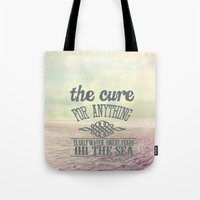 the cure Tote Bags featuring The Cure for Anything  by secretgardenphotography [Nicola]