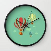 hot air balloon Wall Clocks featuring Hot Air Balloon Ride by Irene Chan
