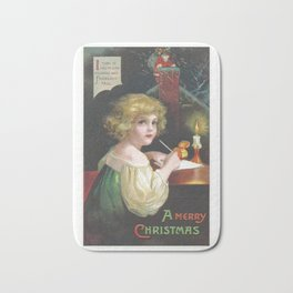 Christmas girl, writing a letter to Santa Claus, was painted by Ellen Clapsaddle Bath Mat
