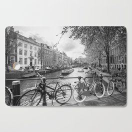 Bicycles parked on bridge over Amsterdam canal Cutting Board
