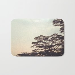 the faint sunset Bath Mat