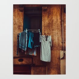Typical Italian balcony with clothes drying in the wind. Poster