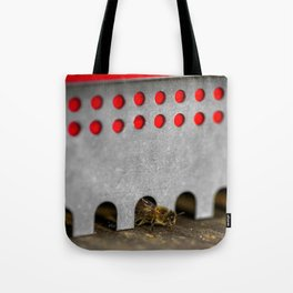The Bee has the entry of the hive Tote Bag