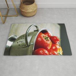 fresh tomatoes (in metal colander) and herbs on a wooden table Rug