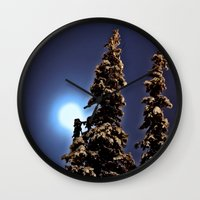 finland Wall Clocks featuring Moonlight in Lapland, Finland by Guna Andersone & Mario Raats - G&M Studi