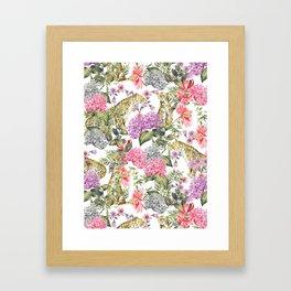 Leopards in flowery garden Framed Art Print