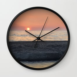 Last Minute At The Beach. At Sunset Wall Clock