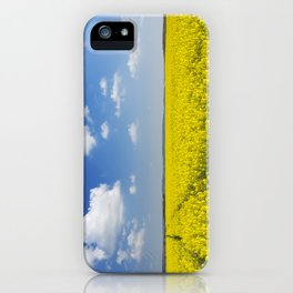 Path through blooming canola under a blue sky with clouds iPhone Case