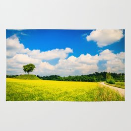 lonely tree in the fields of Italy Rug