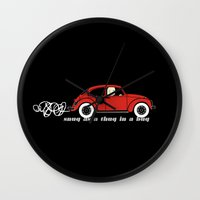 volkswagon Wall Clocks featuring Snug as a Thug in a Bug (red) by The Wallpaper Files