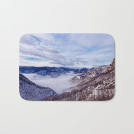 Winter morning in the mountains above the clouds Bath Mat