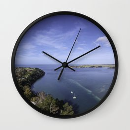 Flying over the coast Wall Clock