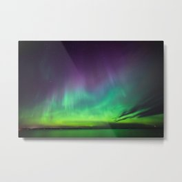 Northern lights over lake in Finland Metal Print