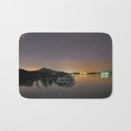 The Big star Sirius the Costelation of Orion and Taurus  reflected at the lake Bath Mat